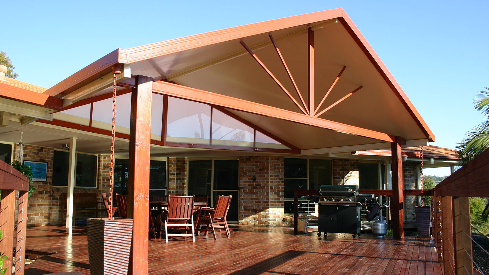 A Gabled Patio Roof over a hardwood Deck